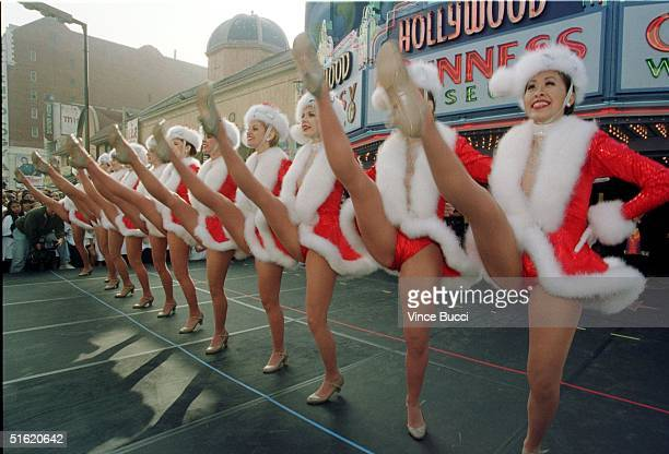 Members of the Radio City Rockettes perform their trademark high kicks outside the Guinness World of Records Museum on Hollywood Boulevard 27 October...