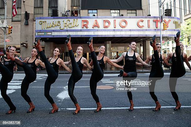 Members of the 'Radio City Rockettes' rehearse before their annual 'Christmas in August' event outside of Radio City Music Hall on 6th Avenue, August...
