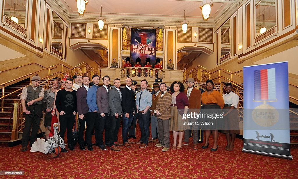 Members of the RAF Squadronaires, The Royal Marine Corps of Drums, cast members of We Will Rock You, War Horse, Spamalot, 42nd Street, Wicked and Some Like It Hot attend a photocall ahead of 'West End Heroes' a gala concert to raise money for Help For Heroes at Dominion Theatre on April 19, 2013 in London, England.