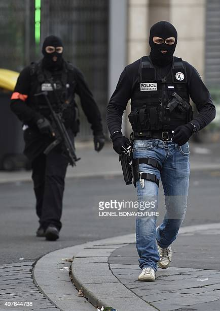 Members of the Raid a special intervention unit of the French police patrol in the northern Paris suburb of SaintDenis city center on November 18 as...