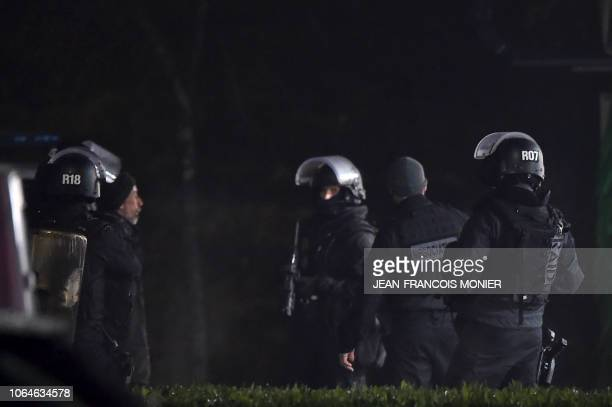 Members of the RAID elite police unit detain a man who was wearing a yellow vest and wielding a grenade which could be tear gas after he surrendered...