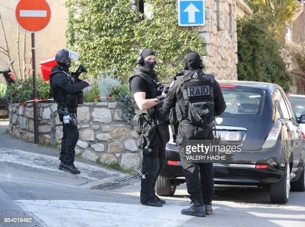 Members of the RAID French police unit stand near the Tocqueville high school in the southern French town of Grasse on March 16 2017 following a...