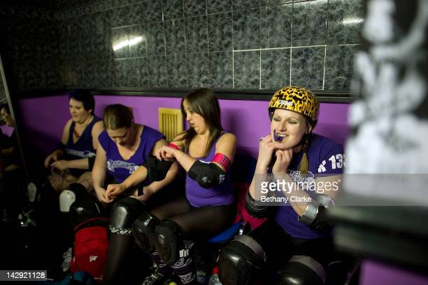 Members of the Rainy City Rollar Girls get ready before the Rollergirls Roller Derby event on April 14 2012 in Oldham England The contact sport of...