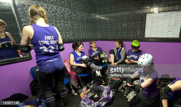 Members of the Rainy City Rollar Girls get ready before the Rollergirls Roller Derby event on April 14, 2012 in Oldham, England. The contact sport of...