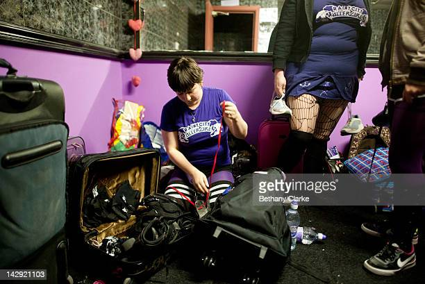 Members of the Rainy City Rollar Girls lace their skates before the Rollergirls Roller Derby event on April 14 2012 in Oldham England The contact...