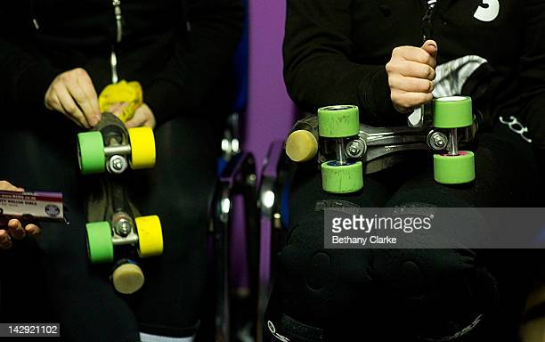 Members of the Rainy City Rollar Girls polish their skates before the Rollergirls Roller Derby event on April 14 2012 in Oldham England The contact...