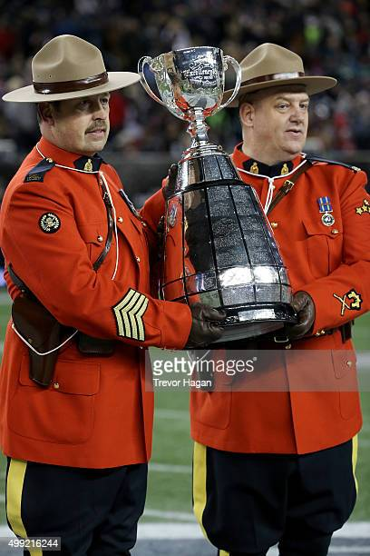 Members of the RCMP hold the Grey Cup prior to the game between the Ottawa Redblacks and Edmonton Eskimos at Investors Group Field on November 29...