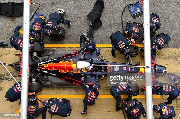 Members of the Red Bull Racing team take part in a pit stop practice session during day two of F1 winter testing at Circuit de Catalunya on March 2,...