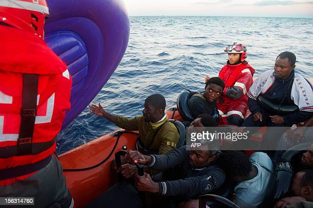 Members of the Red Cross carry an inflatable boat from which they rescued wouldbe immigrants off the Spanish coast six miles from Tarifa on November...
