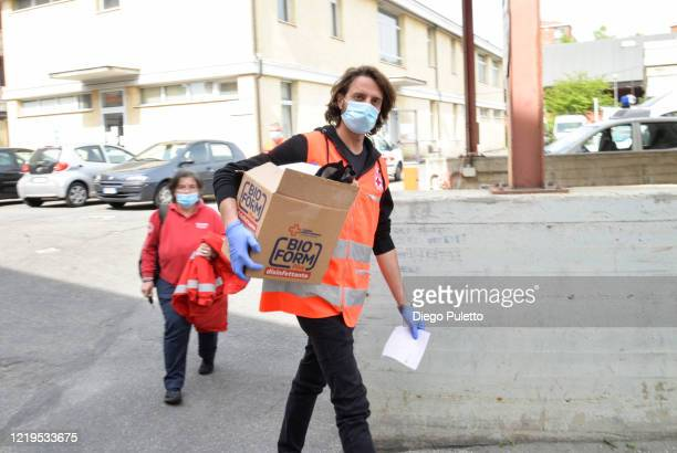 Members of the Red Cross deliver food to people who have financial difficulties during the nationwide lockdown caused by the coronavirus pandemic on...