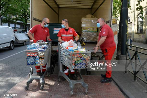 Members of the Red Cross deliver food to people who have suffered financial difficulties during the nationwide lockdown caused by the coronavirus...