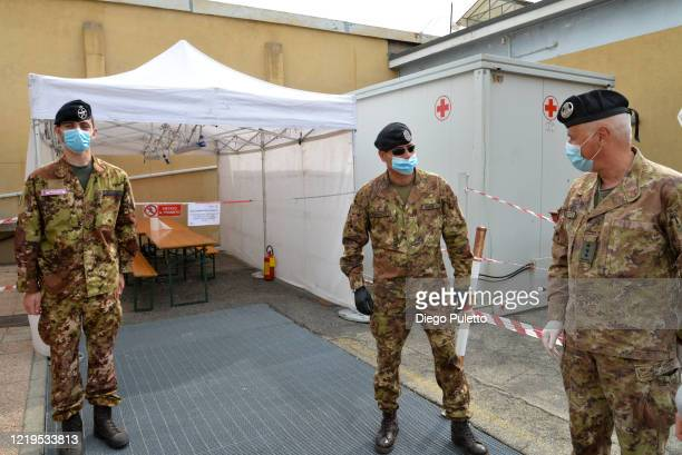 Members of the Red Cross Military during the nationwide lockdown caused by the Coronavirus pandemic on April 18, 2020 in Turin, Italy. The Italian...