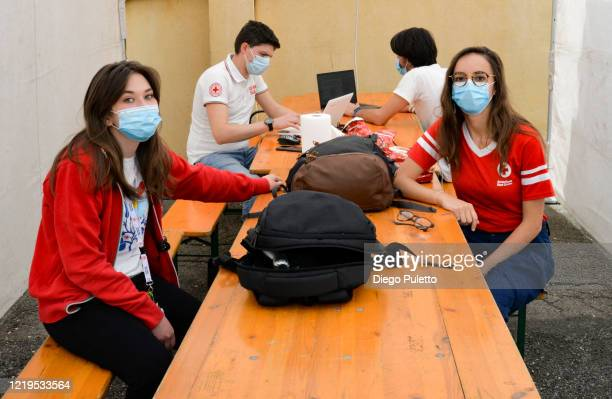 Members of the Red Cross wear face masks at work during the nationwide lockdown to control the spread of the coronavirus on April 18, 2020 in Turin,...