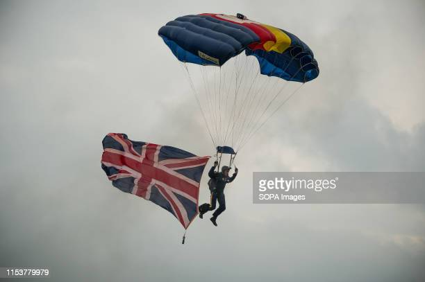 Members of the Red Devils parachute as they demonstrate during the event Stirling shows its support of the UK Armed Forces as part of the UK Armed...