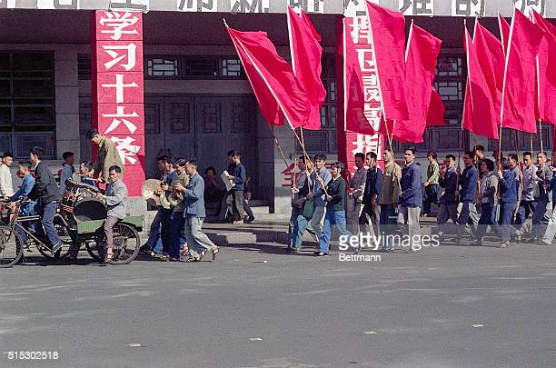 Members of the Red Guards march in demonstrations in Canton China Thousands of adolescents and young adults were enlisted into the Red Guards to...