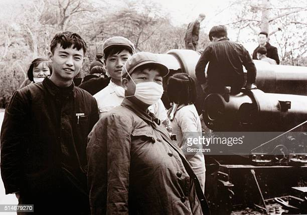 Members of the Red Guards teenage boys and girls stand together some at work with a machine in the Kwantung Province of Canton Thousands of...