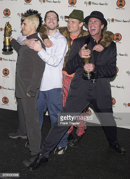 Members of the Red Hot Chili Peppers with their awards