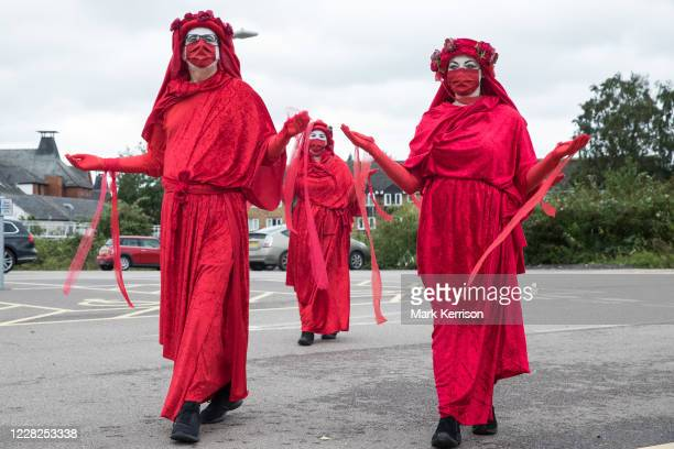 Members of the Red Rebel Brigade join fellow climate activists from Extinction Rebellion at a protest against the expansion of Stansted Airport on 29...
