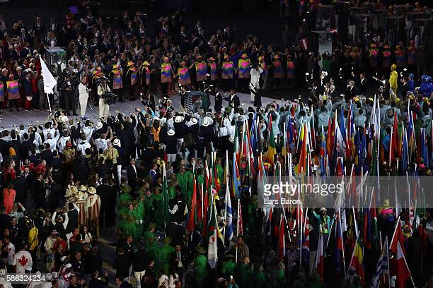 Members of the Refugee Olympic Team enter the stadium during the Opening Ceremony of the Rio 2016 Olympic Games at Maracana Stadium on August 5, 2016...