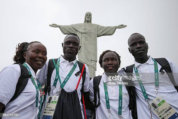 Members of the Refugee Olympic Team pose for a photo in front of the Christ the Redeemer statue on July 30 2016 in Rio de Janeiro Brazil A group of...