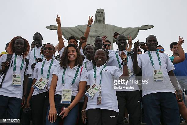 Members of the Refugee Olympic Team pose for a photo in front of the Christ the Redeemer statue on July 30, 2016 in Rio de Janeiro, Brazil. A group...