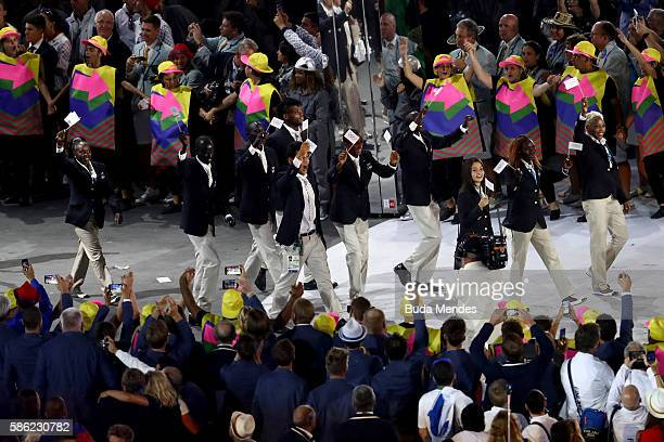 Members of the Refugee Olympic Team take part in the Opening Ceremony of the Rio 2016 Olympic Games at Maracana Stadium on August 5, 2016 in Rio de...