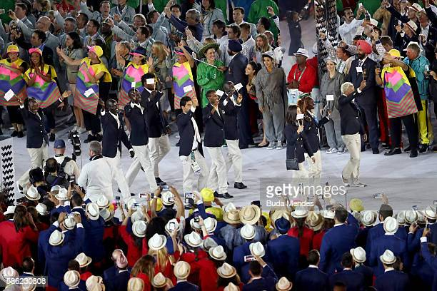 Members of the Refugee Olympic Team take part in the Opening Ceremony of the Rio 2016 Olympic Games at Maracana Stadium on August 5 2016 in Rio de...