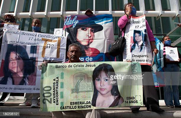 Members of the Relatives and Parents of Missing People Commitee remain outside of the General Prosecutor building during a protest on October 24 2011...