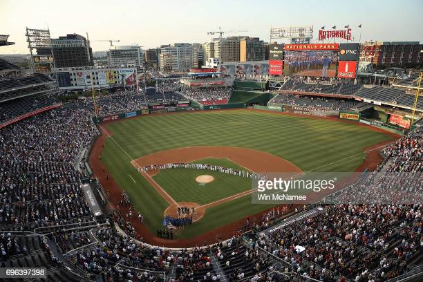 Members of the Republican and Democratic congressional baseball teams gather for a moment of silence before the Congressional Baseball Game at...