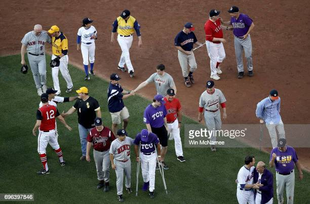 Members of the Republican and Democratic congressional baseball teams greet each other after a bipartisan prayer before the start of the...