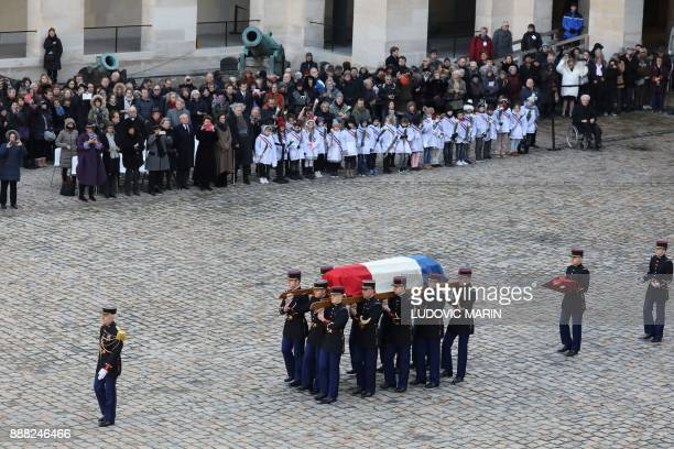 Members of the Republican Guard carry the coffin of late member of the Academie Francaise Jean d'Ormesson during the National Tribute ceremony at the...