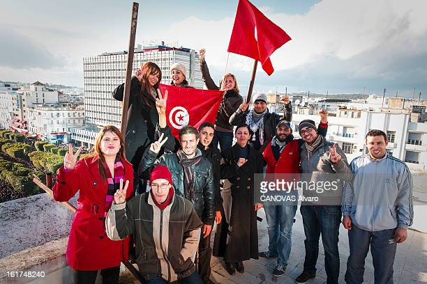 Members of the Republican party posing with Tunisian flags on the roof of the headquarters of the Democratic Movement, an opponent of Ennahda on February 9, 2013 in Tunis,Tunisia.