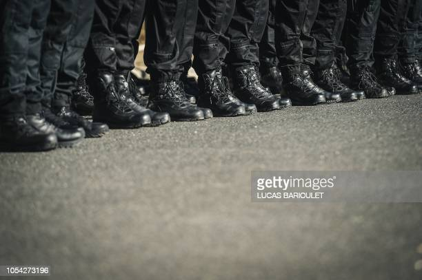 Members of the Research Assistance Intervention Deterrence Police Unit stand in line during the visit of French Interior Minister in the headquarters...