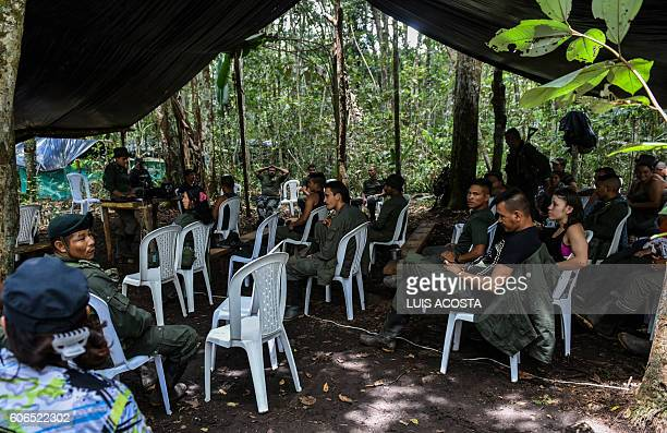 Members of the Revolutionary Armed Forces of Colombia attend a meeting at the camp in Llanos del Yari, Caqueta Department, Colombia, on September 16,...