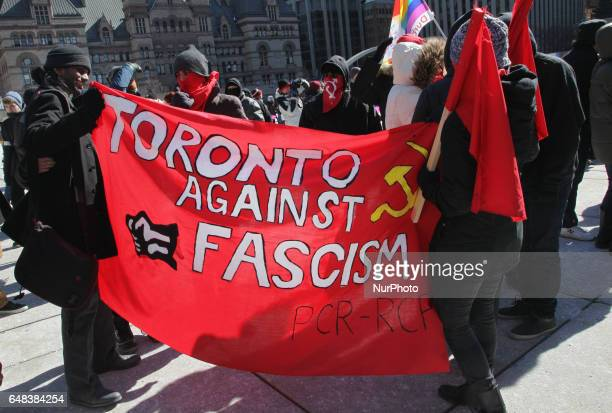 Members of the Revolutionary Communist Party of Canada take part in a counterprotest against antiMuslim groups over the M103 motion to fight...