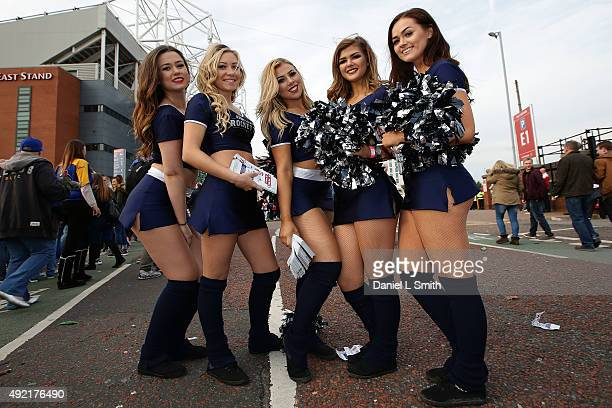 Members of the RFL Rockets Cheerleading squad pose for a photograph prior to the First Utility Super League Grand Final between Leeds Rhinos and...