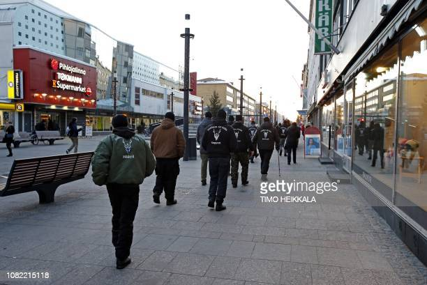 Members of the right wing group Soldiers of Odin walk on a street on January 12 2019 in Oulu Finland / Finland OUT
