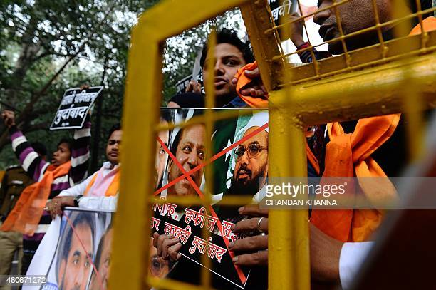 Members of the rightwing Hindu Sena demonstrate as they carry posters bearing the images of Pakistani Prime Minister Nawaz Sharif and Hafiz Muhammad...