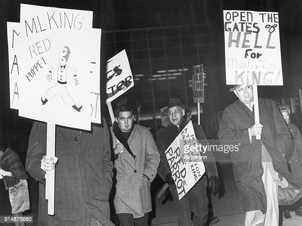 Members of the right-wing organization break through picket outside Cobe Hall in dissent of Rev. Martin Luther King who addressed a dinner inside.