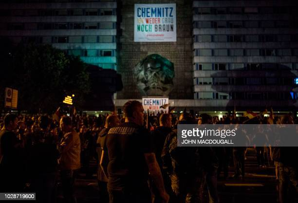 """Members of the right-wing populist """"Pro Chemnitz"""" movement gather at the Karl Marx monument after having marched through the streets of Chemnitz on..."""