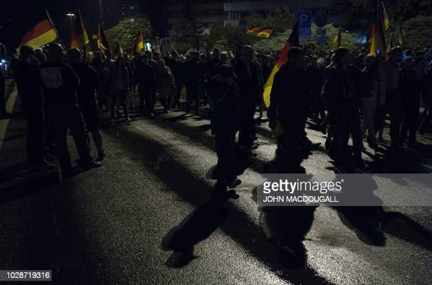 """Members of the right-wing populist """"Pro Chemnitz"""" movement march through the streets of Chemnitz on September 7, 2018. - Thousands of protesters..."""