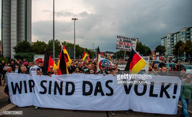 Members of the rightwing populist Pro Chemnitz movement march through the streets of Chemnitz on September 7 2018 Thousands of protesters gathered to...