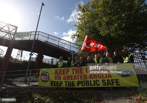 Members of the RMT union on the picket line as they stage a 24hour strike at Colchester station as workers on Southern Merseyrail Arriva Rail North...