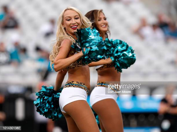 Members of the ROAR Cheerleaders from the Jacksonville Jaguars performs before the start of a preseason game against the New Orleans Saints at TIAA...