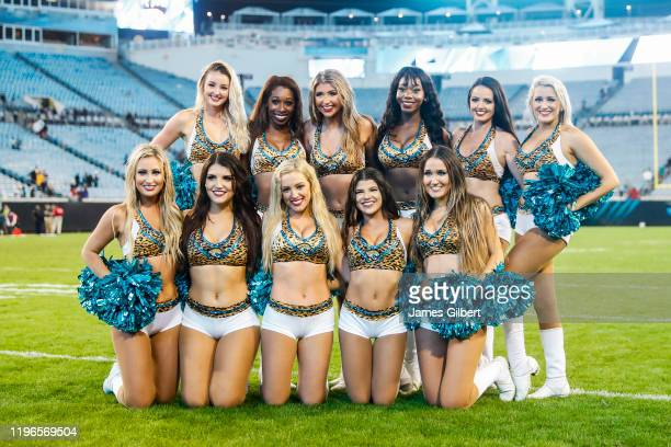 Members of the ROAR, the Jacksonville Jaguars cheerleading squad, pose for a photo after the final game of the year against the Indianapolis Colts at...