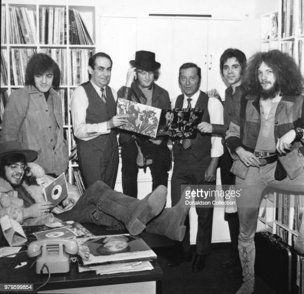Members of the rock and roll band Jethro Tull pose for a portrait with their album This Was and record label executives in 1968 in New York