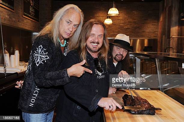 Members of the rock band Lynyrd Skynyrd Gary Rossington Johnny Van Zant and Ricky Medlocke during the grand opening of Lynyrd Skynyrd BBQ Beer at...