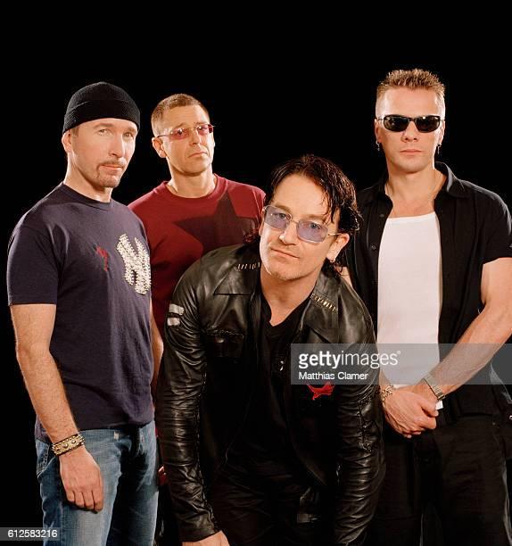 Members of the rock band U2 lead guitarist The Edge bassist Adam Clayton vocalist Bono and drummer Larry Mullen Jr