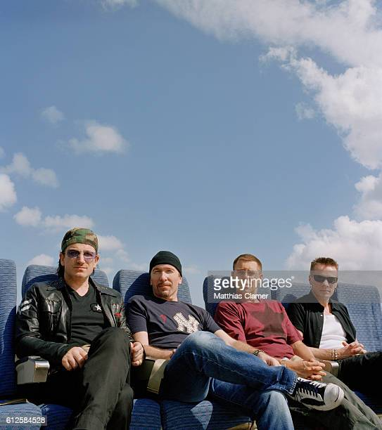 Members of the rock band U2 vocalist Bono lead guitarist The Edge bassist Adam Clayton and drummer Larry Mullen Jr