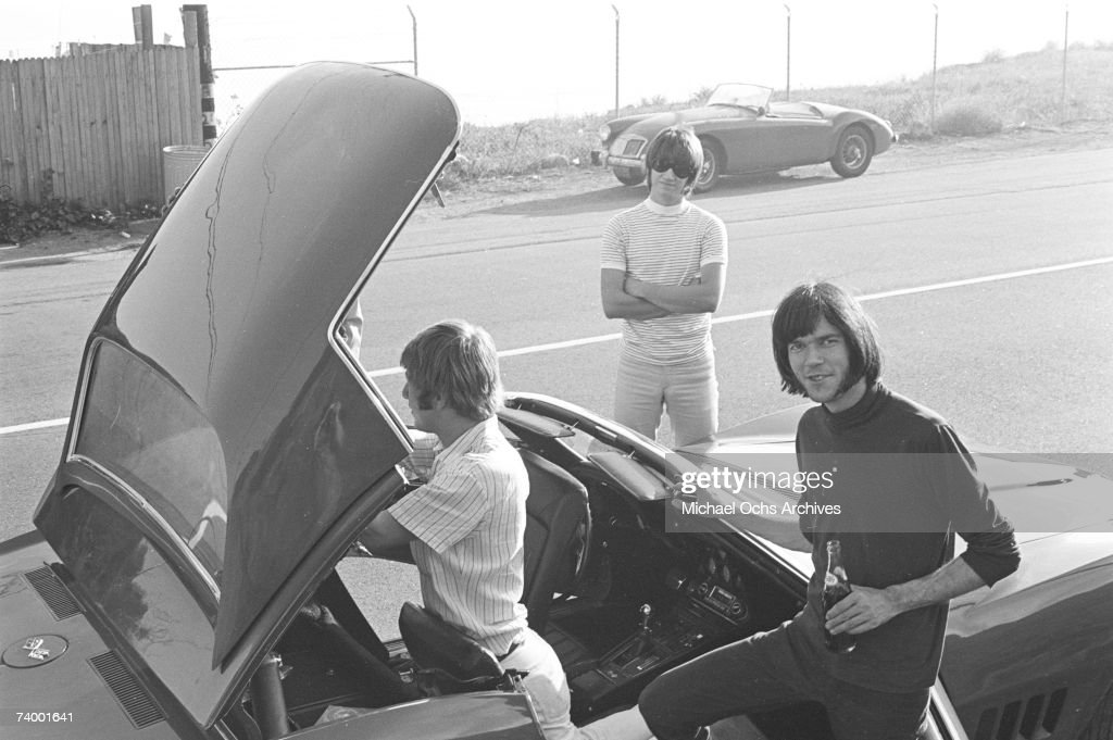 Members of the rock group 'Buffalo Springfield' take the top off of their Corvette on October 30, 1967 in Malibu, California. (L-R) Dewey Martin, Richie Furay and Neil Young.